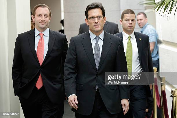 House Majority Leader Eric Cantor arrives for a meeting of House Republicans on the proposed Senate debt limit and government shutdown deal October...