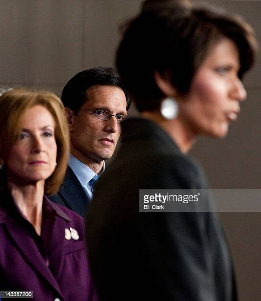 House Majority Leader Eric Cantor RVa center and Rep Nan Hayworth RNY left listens as Rep Kristi Noem RS Dak speaks during the House Republicans'...