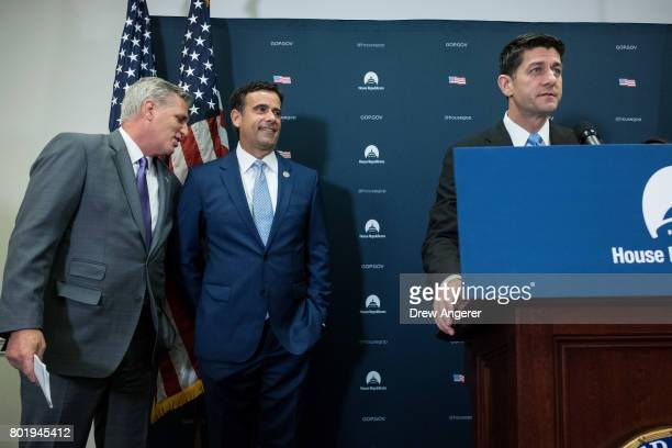 House Majority Leader Kevin McCarthy and Rep John Ratcliffe look on as Speaker of the House Paul Ryan speaks during a press conference following a...