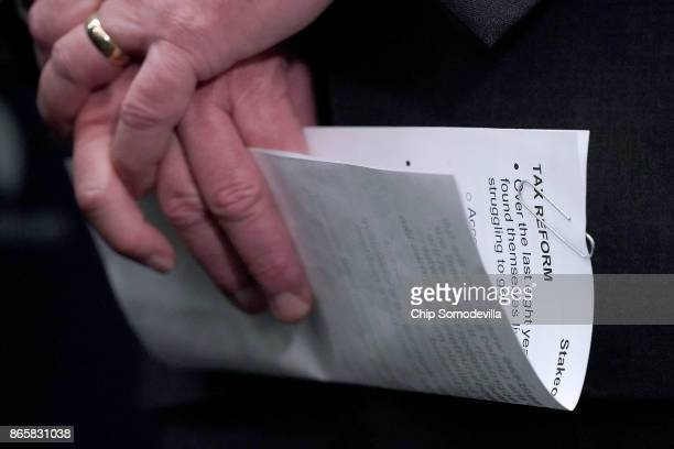 House Majority Leader Kevin McCarthy holds his notes before talking to reporters following the weekly House Republican Conference meeting at the US...