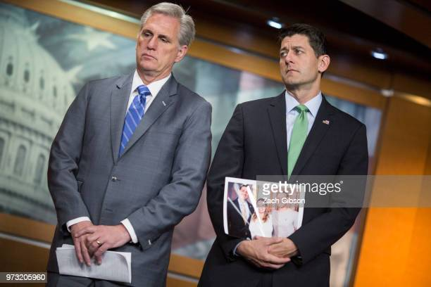 S House Majority Leader Kevin McCarthy left and House Speaker Paul Ryan holding a photograph of himself with people in his district who have been...