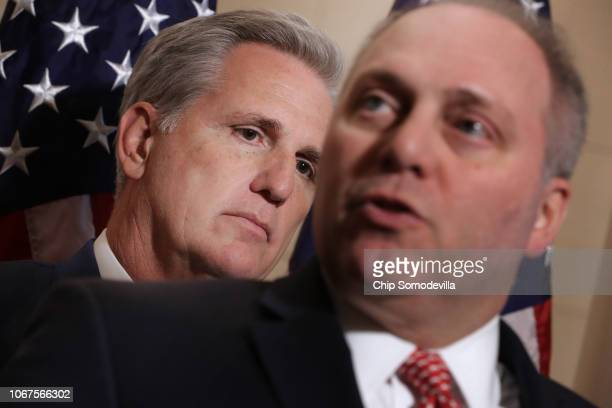 House Majority Leader Kevin McCarthy listens to Majority Whip Steve Scalise talk to reporters following House GOP leadership elections in the...