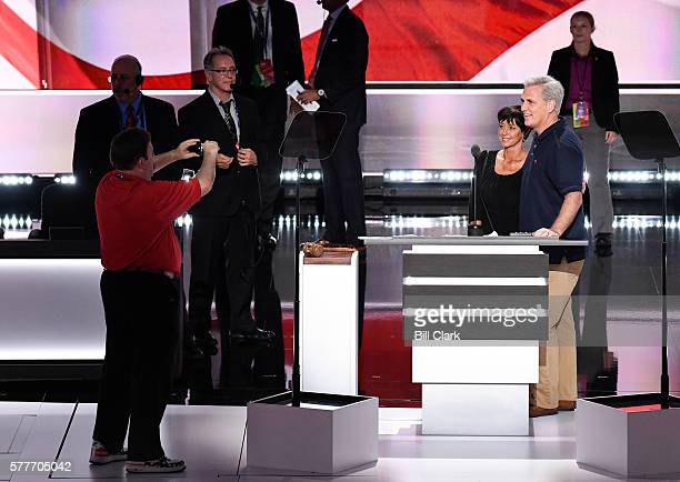 House Majority Leader Kevin McCarthy poses with his wife Judy as pollster Frank Luntz takes their photo at the podium in the Quicken Loans Arena at...