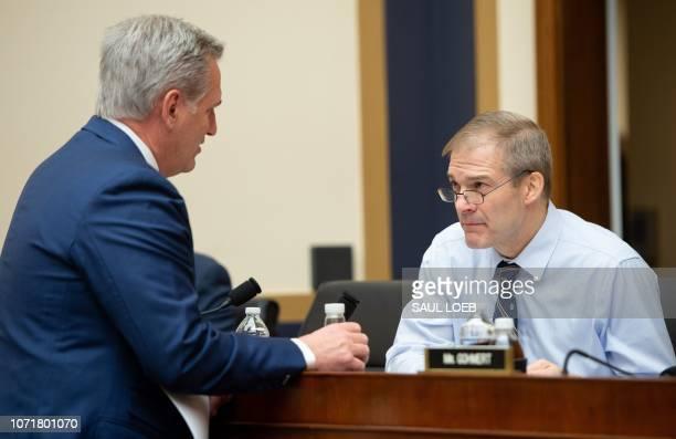 US House Majority Leader Kevin McCarthy Republican of California speaks with Representative Jim Jordan Republican of Ohio prior to testimony by...