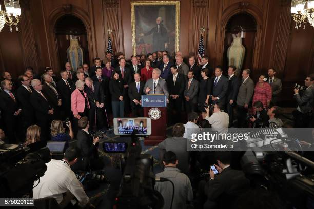 House Majority Leader Kevin McCarthy speaks to the news media with fellow House Republicans following the passage of the Tax Cuts and Jobs Act in the...