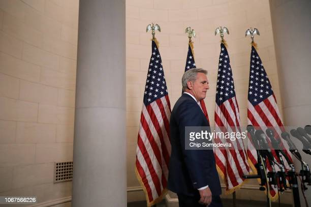 House Majority Leader Kevin McCarthy walks to the microphones to talk to reporters following his election to House minority leader for the next...