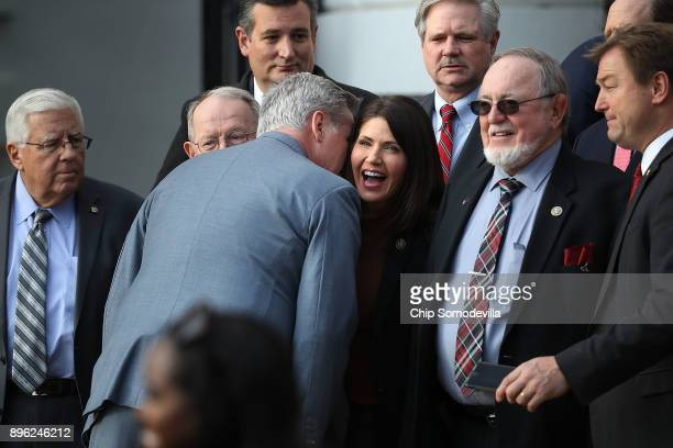 House Majority Leader Kevin McCarthy whispers to Rep. Kristi Noem during an event to celebrate Congress passing the Tax Cuts and Jobs Act with Sen....
