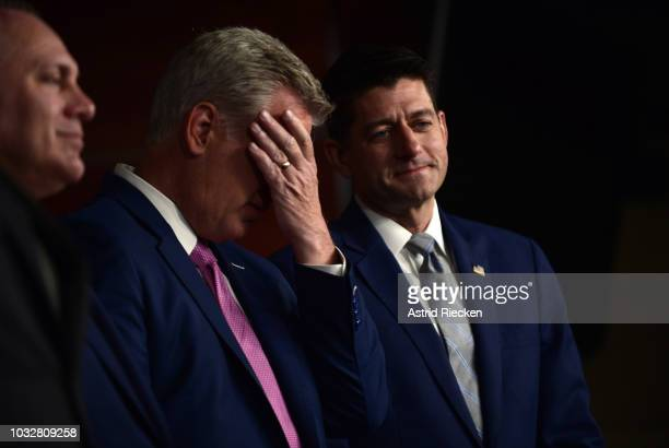 House Majority Leader Kevin Owen McCarthy Republican Congressman for California's 23rd district covers his face while standing next to House Speaker...