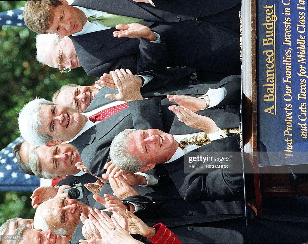 Us house majority leader newt gingrich behind cli pictures us house majority leader newt gingrich behind clinton r ga applaudes us president platinumwayz
