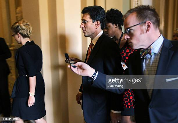 S House Majority Leader Rep Eric Cantor is followed by reporters as he arrives for a meeting with US Vice President Joseph Biden June 14 2011 on...