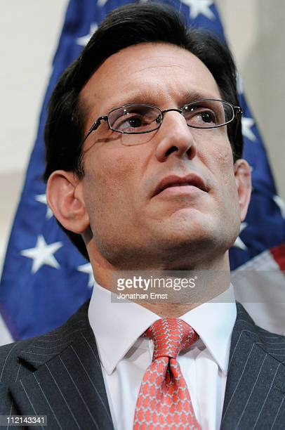 S House Majority Leader Rep Eric Cantor listens as Speaker Rep John Boehner addresses reporters at the US Capitol on April 13 2011 in Washington DC...