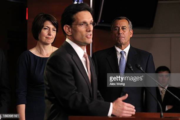 S House Majority Leader Rep Eric Cantor speaks as Speaker of the House Rep John Boehner and Rep Cathy McMorris Rodgers listen during a news...