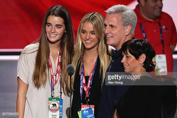 S House Majority Leader Rep Kevin McCarthy poses for a picture with attendees on stage prior to the start of the second day of the Republican...