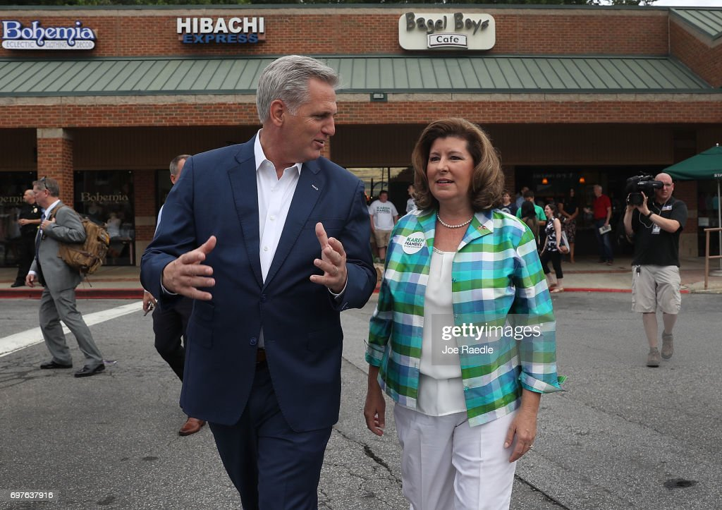 House Majority Leader Rep. Kevin McCarthy (R-CA) (L) walks with Republican candidate Karen Handel during a campaign stop as she runs for Georgia's 6th Congressional District on June 19, 2017 in Alpharetta, Georgia. Handel is running in a special election against the Democratic challenger Jon Ossoff to replace Tom Price, who is now the Secretary of Health and Human Services. The election will fill a congressional seat that has been held by a Republican since the 1970s.