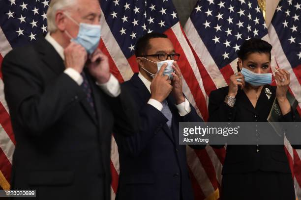 House Majority Leader Rep. Steny Hoyer , Rep. Kweisi Mfume and his wife Tiffany McMillan Mfume put on a mask after a ceremonial swearing-in at the...