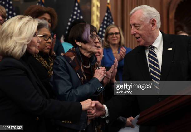 S House Majority Leader Rep Steny Hoyer shakes hands with women's equality activist Lilly Ledbetter as Rep Rosa Delauro looks on during a news...