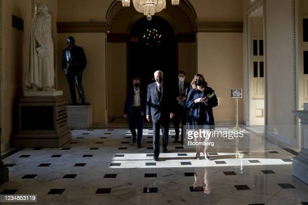 House Majority Leader Steny Hoyer, a Democrat from Maryland, center, wears a protective mask while walking through the U.S. Capitol in Washington,...