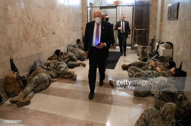 House Majority Leader Steny Hoyer, Democrat of Maryland, walks past members of the National Guard as he arrives at the US Capitol in Washington, DC,...