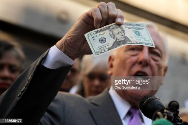 House Majority Leader Steny Hoyer holds up a $20 bill while rallying with House Democrats to demand that American abolitionist heroine Harriet...