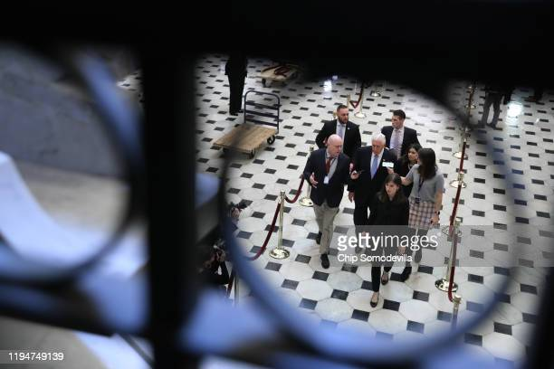 House Majority Leader Steny Hoyer is questioned by reporters as he walks through Statuary Hall at the US Capitol December 18 2019 in Washington DC...