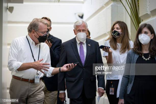 House Majority Leader Steny Hoyer talks with reporters as he arrives for a closed-door meeting with House Democrats at the U.S. Capitol September 27,...