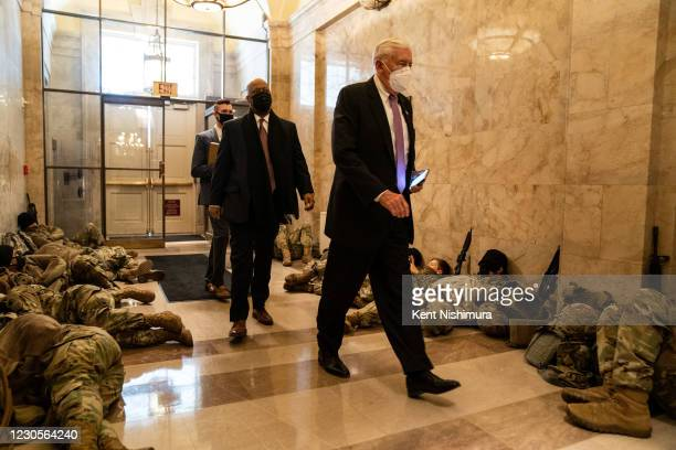 House Majority Leader Steny Hoyer walks past members of the National Guard sleeping in the halls of Capitol Hill as the House of Representativs...