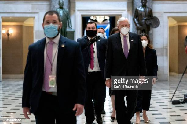 House Majority Leader Steny Hoyer wears a protective mask while walking to the House Floor at the U.S. Capitol on January 13, 2021 in Washington, DC....