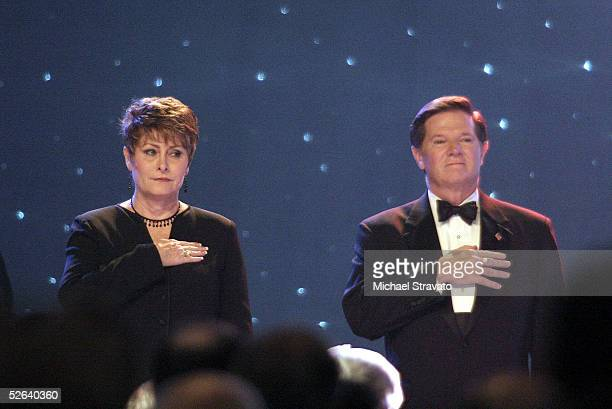 House Majority Leader Tom DeLay and wife Christine acknowledge the Pledge of Allegiance during the National Rifle Association's Annual Meeting on...