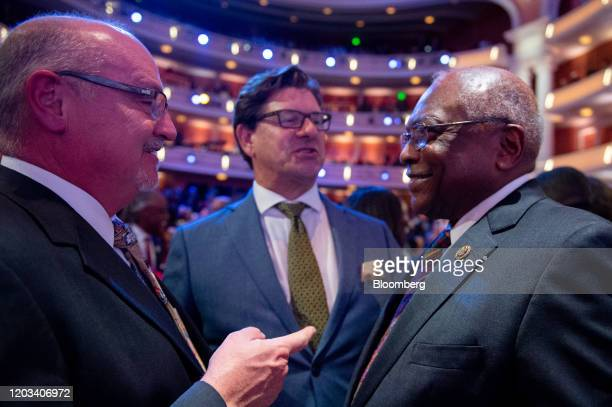 House Majority Whip James Clyburn a Democrat from South Carolina right attends the Democratic presidential debate in Charleston South Carolina US on...