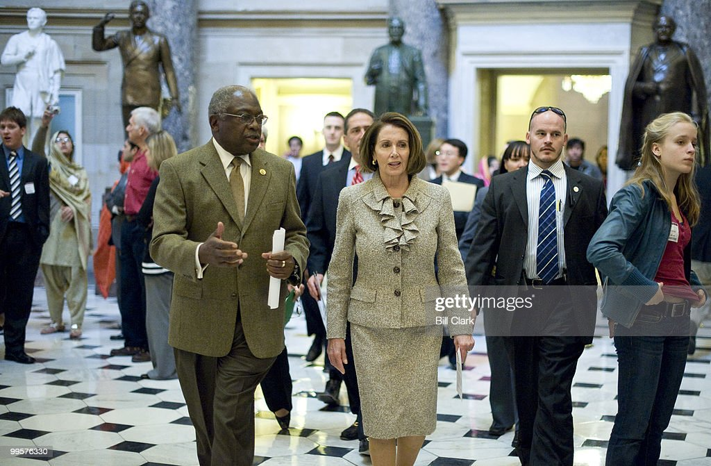 House Majority Whip James Clyburn, D-S.C., and Speaker of the House Nancy Pelosi, D-Calif., walk through Statuary Hall on their way to their news conference on healthcare reform on Friday, Oct. 23, 2009.
