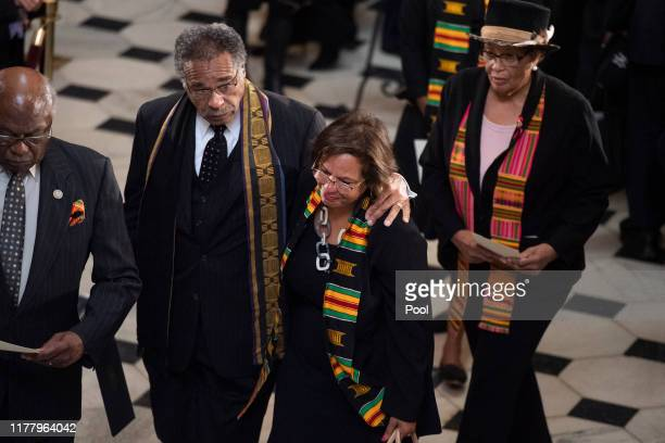House Majority Whip Jim Clyburn Rep Emanuel Cleaver Rep Robin Kelly and Rep Alma Adams pay their respects to the late Rep Elijah Cummings during his...