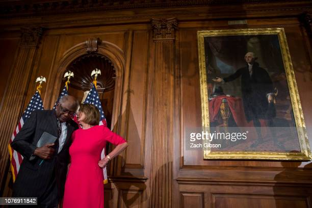 House Majority Whip Jim Clyburn speaks to House Speaker Nancy Pelosi during a ceremonial mock swearing in ceremony on Capitol Hill on January 3 2019...