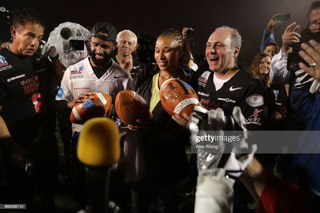 U.S. House Majority Whip Rep. Steve Scalise (R-LA) (R), and officers Crystal Griner (2nd L) and David Bailey (L) who were in his security detail that saved his life in the congressional baseball practice shooting, are presented with ceremonial footballs during halftime of the 2017 Congressional Football Game October 11, 2017 at Gallaudet University in Washington, DC. Members of Congress and former NFL players team up against the U.S. Capitol Police for the biennial Congressional Football Game, which began in 2005 following the loss of Capitol Police officers John Gibson and Jacob Chestnut in the line of duty in 1998, to raise money to benefit the families of fallen police officers.