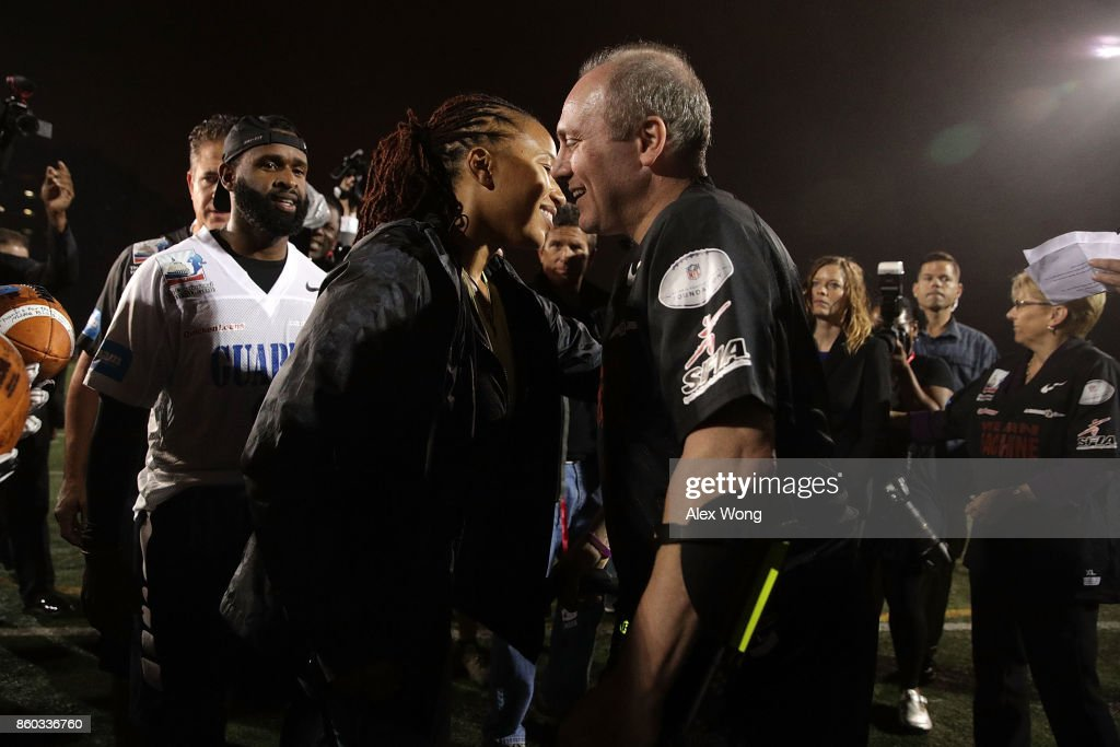 U.S. House Majority Whip Rep. Steve Scalise (R-LA) (R) greets officers Crystal Griner (2nd L) and David Bailey (L) who were in his security detail that saved his life in the congressional baseball practice shooting, during halftime of the 2017 Congressional Football Game October 11, 2017 at Gallaudet University in Washington, DC. Members of Congress and former NFL players team up against the U.S. Capitol Police for the biennial Congressional Football Game, which began in 2005 following the loss of Capitol Police officers John Gibson and Jacob Chestnut in the line of duty in 1998, to raise money to benefit the families of fallen police officers.