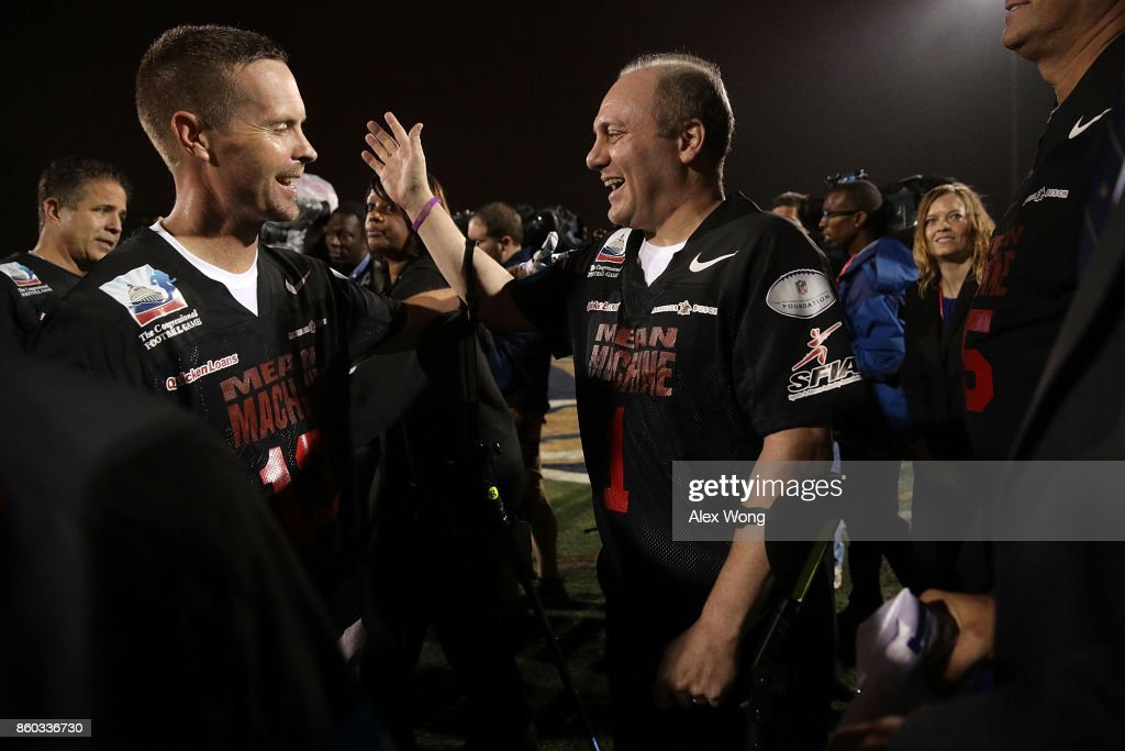 U.S. House Majority Whip Rep. Steve Scalise (R-LA) (R) greets Rep. Rodney Davis (R-IL) (L) during halftime of the 2017 Congressional Football Game October 11, 2017 at Gallaudet University in Washington, DC. Members of Congress and former NFL players team up against the U.S. Capitol Police for the biennial Congressional Football Game, which began in 2005 following the loss of Capitol Police officers John Gibson and Jacob Chestnut in the line of duty in 1998, to raise money to benefit the families of fallen police officers.