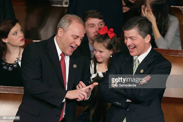 House Majority Whip Steve Scalise talks with Rep Jeb Hensarling during the opening session of the 114th Congress inside the House of Representatives...