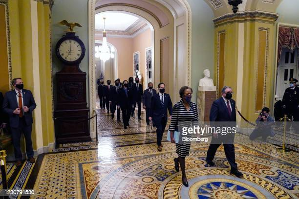 House managers walk the article of impeachment against President Donald Trump during a procession to the Senate Chamber in Washington, D.C., U.S., on...
