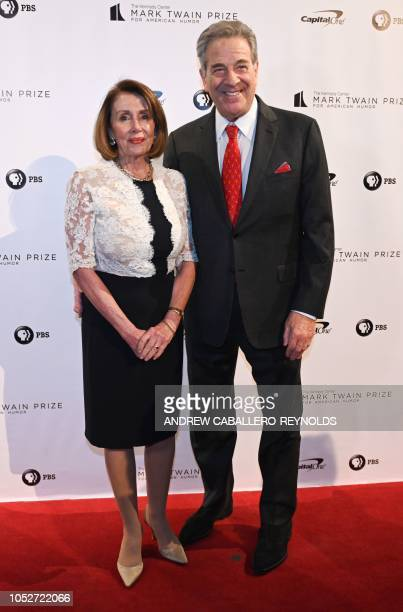House member Nancy Pelosi and her husband Paul Pelosi pose on the red carpet for the 21st Annual Mark Twain Prize for American Humor at the Kennedy...
