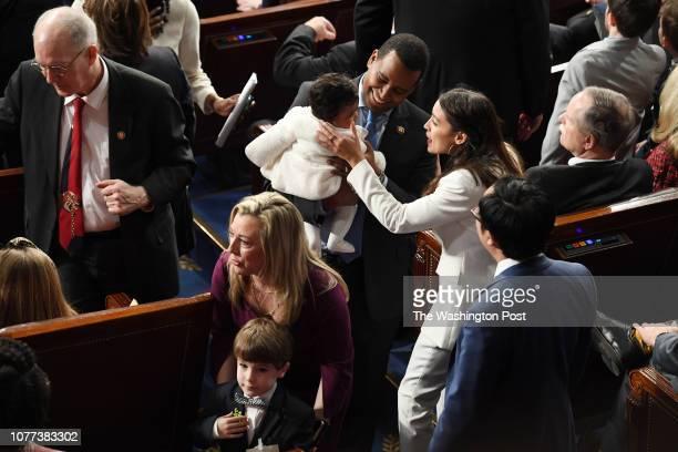 House members Joe Neguse and Alexandria OcasioCortez talk as the 116th United States Congress convenes on Thursday January 03 2019 in Washington DC