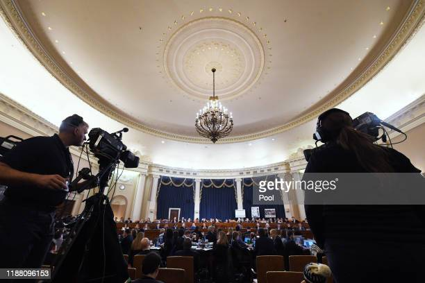 House members, media and others are seen during a House Judiciary Committee markup of Articles of Impeachment against President Donald Trump at the...