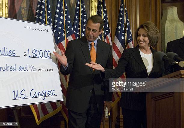 House Minority Leader John A Boehner ROhio and House Speaker Nancy Pelosi DCalif gesture toward a tax rebate check mockup during a news conference on...