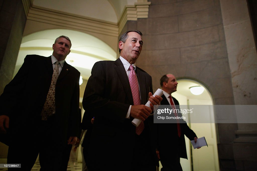 House Minority Leader John Boehner (R-OH) (C) heads for a meeting with Republican governors-elect at the U.S. Capitol December 1, 2010 in Washington, DC. The GOP leaders talked about ways to create jobs, cut spending and ways to repeal the health care law.