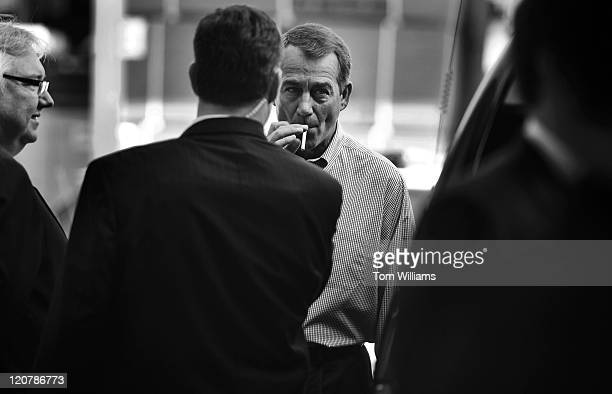 House Minority Leader John Boehner ROhio smokes a cigarette after a news conference outside of Tart Lumber Company in Sterling Va where republican...