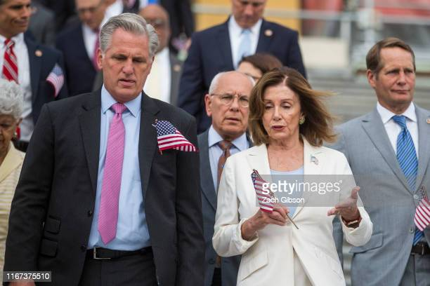 House Minority Leader Kevin McCarthy and House Speaker Nancy Pelosi make their way down the Capitol Steps during an observance and campus wide moment...