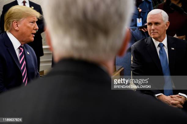 House Minority Leader Kevin McCarthy and US Vice President Mike Pence listen to US President Donald Trump speak during a meeting with Rep Jeff Van...