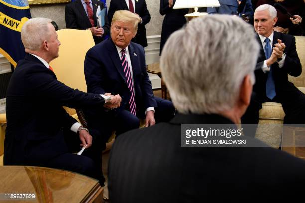 House Minority Leader Kevin McCarthy and US Vice President Mike Pence watch as US President Donald Trump and Rep Jeff Van Drew who is switching from...