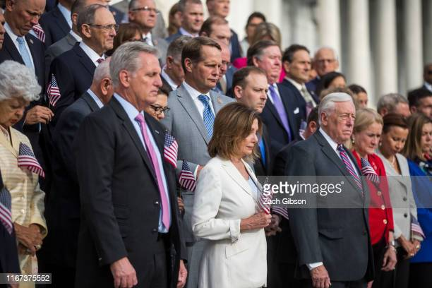 House Minority Leader Kevin McCarthy House Speaker Nancy Pelosi and House Majority Leader Steny Hoyer take part in a moment of silence on the Capitol...