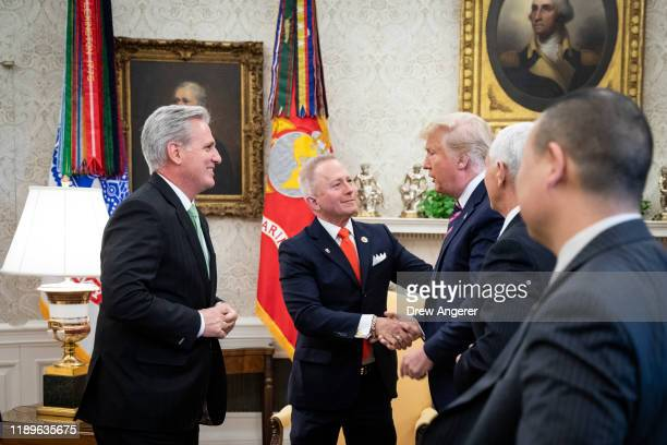 House Minority Leader Kevin McCarthy looks on as US Representative Jeff Van Drew of New Jersey who has announced he is switching from the Democratic...