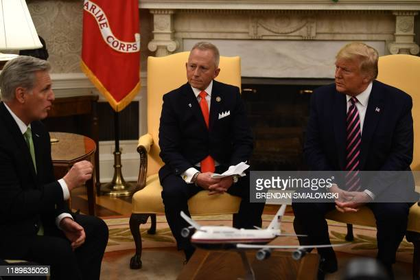House Minority Leader Kevin McCarthy RCA speaks with US President Donald Trump and Rep Jeff Van Drew in the Oval Office at the White House on...