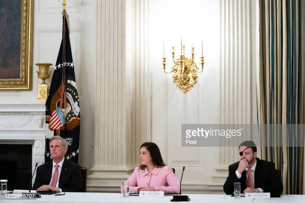 House Minority Leader Kevin McCarthy , Rep. Elise Stefanik and Rep. Dan Crenshaw attend a meeting with U.S. President Donald Trump and fellow...